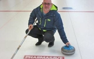 Pharmasave logo on curling ice
