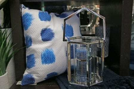 Accent pillow and candle